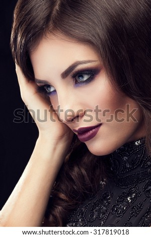 Romantic woman portrait with professional make up. Black background. Studio shooting. Beauty and fashion. Sensuality and classy style