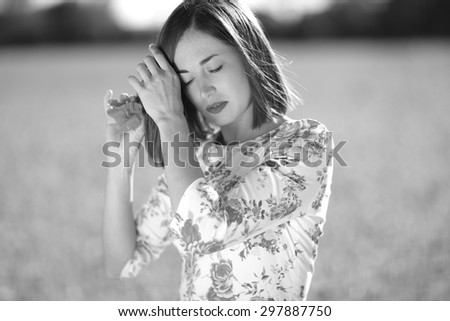 Romantic woman putting a flower in her hair