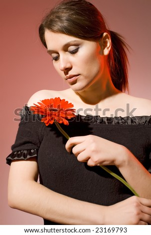 romantic woman with red flower - stock photo