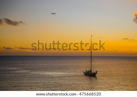 Romantic yellow sunset with a yacht at Caribbean, Martinique