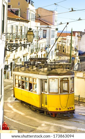 Romantic yellow tramway - main symbol of Lisbon, Portugal  - stock photo