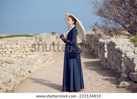 Romantic young beautiful lady outdoors    - stock photo