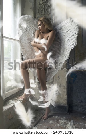 Romantic young beauty as an angel - stock photo