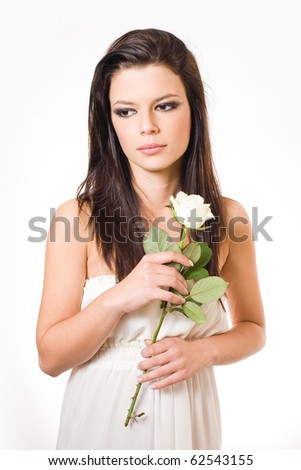 Romantic young brunette with white rose.