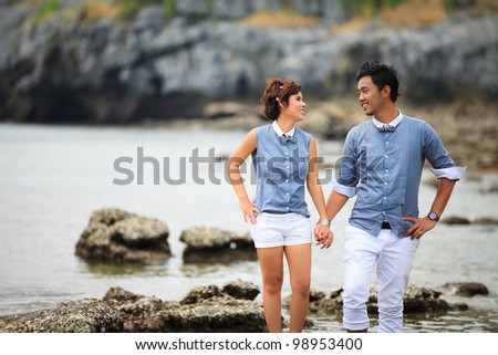 Romantic young couple at sea - stock photo