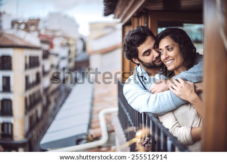 Romantic young couple at window - stock photo