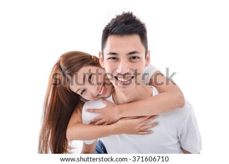 Romantic young couple in casual clothing, white background    - stock photo