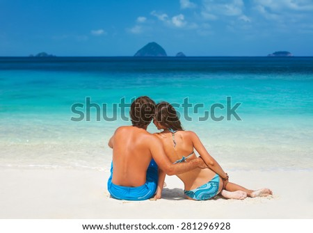 Romantic young couple in love on the beach