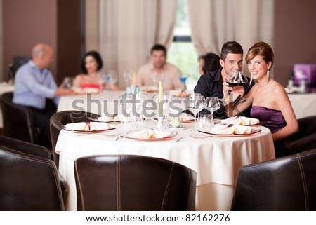 romantic young couple in restaurant date toast