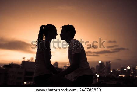 Romantic young couple kissing in the city - stock photo