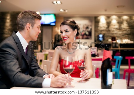 romantic young couple on first date in restaurant