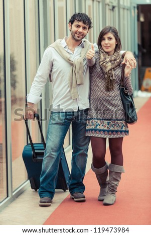 Romantic Young Couple on Vacation, Thumbs Up - stock photo