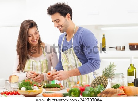 Romantic young couple preparing italian food at home. - stock photo