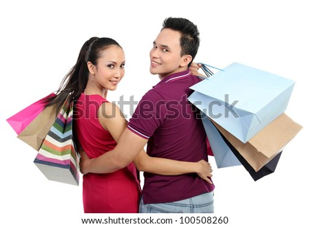 Romantic young couple shopping isolated on white background - stock photo