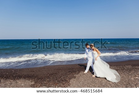 Romantic young couple walking along the sea