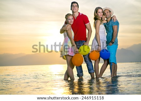 Romantic Young Couples Posing at the Beach While Looking at the Camera. Captured on One Afternoon. - stock photo