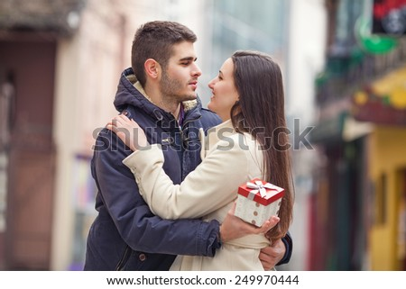 Romantic young man holding gift for his girlfriend - stock photo