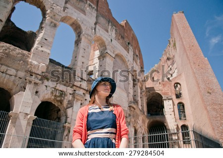 Romantic young travel woman in summer hat  by Colosseum, Rome, Italy - stock photo