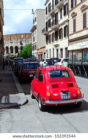 ROME - April 24 Fiat 500 on the street in the center of Rome. Fiat 500 was produced by the Fiat company from 1957 to 75. New version of the car started production in 2007. Seen on April 24, 2012. Rome - stock photo