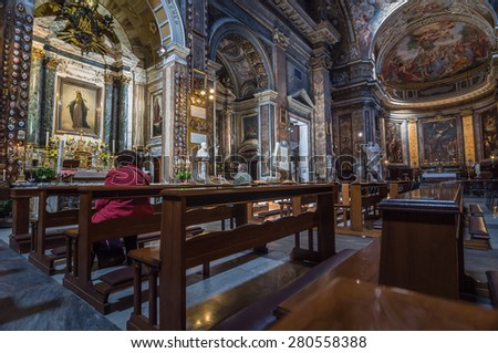 ROME - APRIL 17, 2013: Interior of the Saint Andrea of Fratte. It is a basilica church in Baroque style. People are pray to the image of Divine Mother and her Miraculous Medal. Rome, Lazio, Italy.