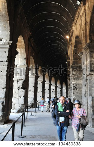 ROME - APRIL 29:Mature couple visit at the Colosseum on April 29 2011 in Rome Italy.The Coliseum in Rome has over 80 entrances and can accommodate about 50,000 spectators.  - stock photo