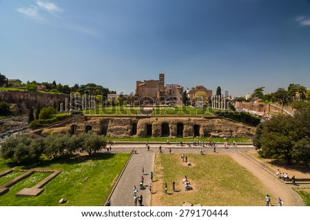 ROME - APRIL 17, 2013: Tourists walk next to Forum Romanum on a sunny spring day with clear blue sky. Temple of Venus and Roma and seen from the Colosseum (Coliseum). Rome, Italy. - stock photo