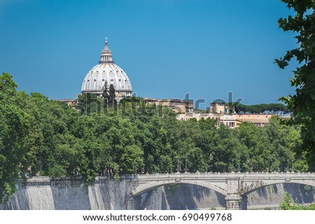Rome architectural masterpiece dome is rising above summer street with Tiber river bridge