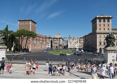 ROME - AUGUST 15: People walk in Piazza Venezia on Augustl 15, 2015 in Rome, Italy.  - stock photo