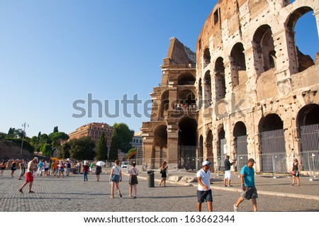 ROME-AUGUST 8: The Colosseum on August 8,2013 in Rome, Italy. The Colosseum is an elliptical amphitheatre in the centre of the city of Rome, Italy. - stock photo