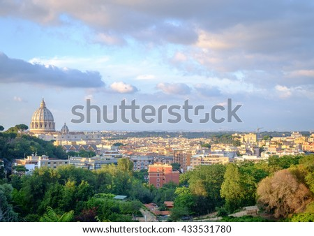 Rome cityscape with view of san peters's cathedral dome - stock photo