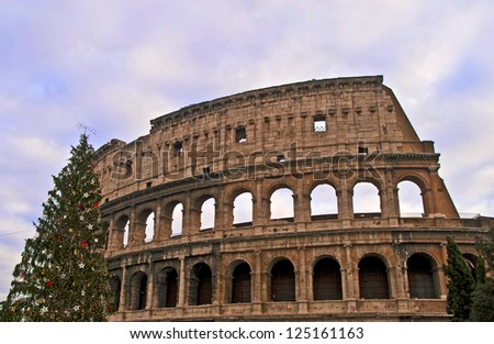 ROME - DECEMBER 18: Colosseum facade on December 18, 2011 in Rome. The Colosseum is an elliptical amphitheatre in the centre of Rome and is considered one of the greatest works of Roman architecture.