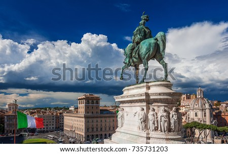 Rome historic city center with Italian Flag and beautiful clouds panoramic view from Altar of Nation Monument