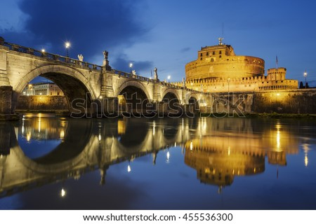 Rome. Image of the Castle of Holy Angel and Holy Angel Bridge over the Tiber River in Rome bynight. - stock photo