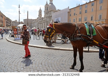 ROME, ITALY - APRIL 18, 2015: A man with horse in Piazza Navona, famous place in Rome. Italy - stock photo