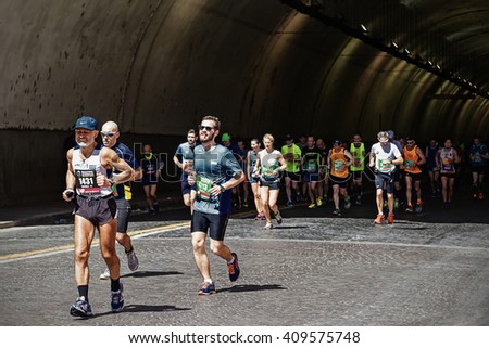 Rome, Italy - April 10, 2016: Athletes participating in the Rome Marathon 2016, during the race through the streets of the city.