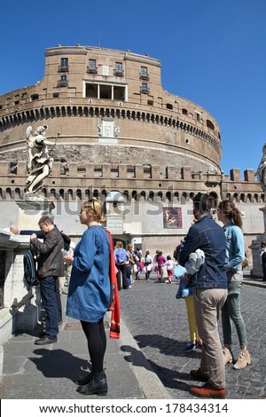 ROME, ITALY - APRIL 10, 2012: People visit famous Castel Sant' Angelo in Rome. According to Euromonitor, Rome is the 3rd most visited city in Europe (5.5m international tourist arrivals 2009) - stock photo