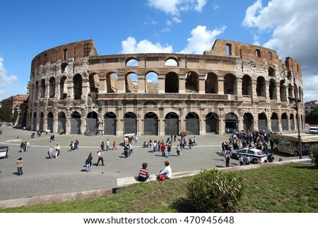 ROME, ITALY - APRIL 8, 2012: People visit the Colosseum in Rome. According to official data Rome was visited by 12.6 million people in 2013.