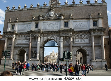 ROME, ITALY - APRIL 25: People walks by the gate into the Piazza del Popolo in Rome, Italy on April 25, 2016