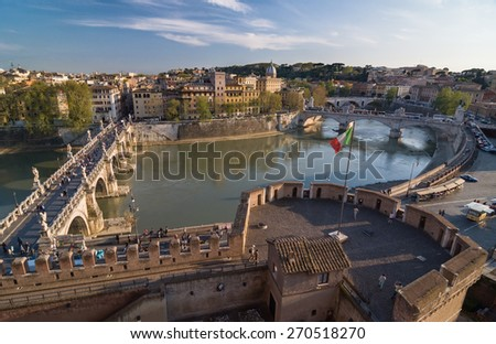 ROME, ITALY - APRIL 16, 2013: Ponte Sant'Angelo and Ponte Vittorio Emanuele II across the Tiber river. Aerial view from the Mausoleum of Hadrian, known as Castle of the Holy Angel. Rome, Italy. - stock photo