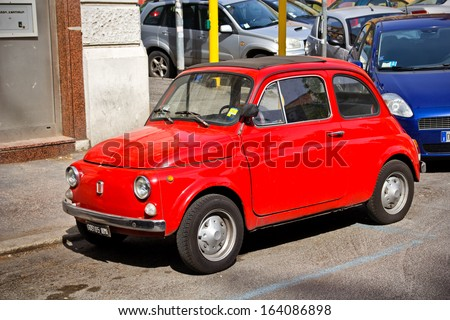 ROME, Italy - APRIL 16: Red Fiat 500 car on April 16, 2012 in Rome Italy. One of a famous European vintage cars, the little Fiat 500  - stock photo