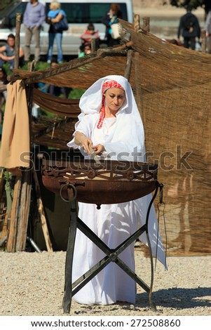 ROME, ITALY - APRIL 21, 2015:  Rome Foundation Anniversary historical reconstruction, priestess  lights the sacred fire - stock photo