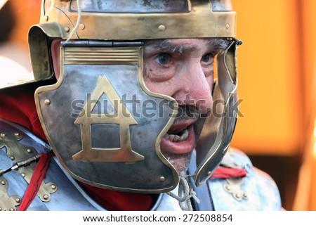 ROME, ITALY - APRIL 21, 2015:  Rome Foundation Anniversary historical reconstruction, Roman legionary closeup - stock photo