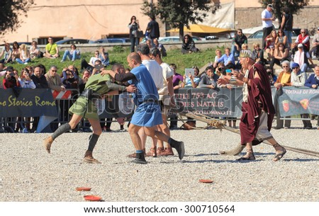 ROME, ITALY - APRIL 21, 2015:  Rome Foundation Anniversary historical reconstruction, Romulus kills his brother Remus - stock photo