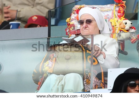ROME, ITALY - April 2016 : Sister supporter in tribune during fotball match  serie A  League 2015/2016 between A.s. Roma  vs Napoli  at the Olimpic Stadium  on april 25, 2016 in Rome. - stock photo