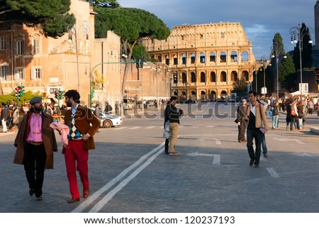 ROME, ITALY-APRIL 21, 2012: The Colosseum, or the Coliseum, one of the greatest works of Roman architecture and Roman engineering, at the end of the street, on April 21, 2012 in Rome.