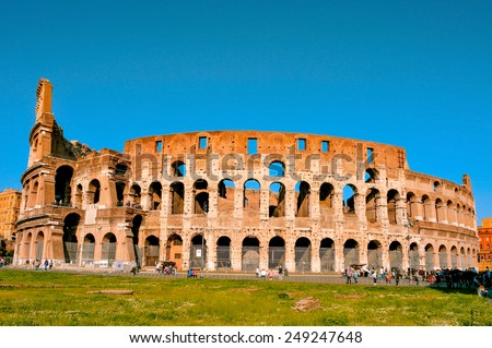 ROME, ITALY - APRIL 17: The Flavian Amphitheatre or Coliseum on April 17, 2013 in Rome, Italy. The Coliseum is an iconic symbol of Rome and one of the most popular tourist attractions in the city - stock photo