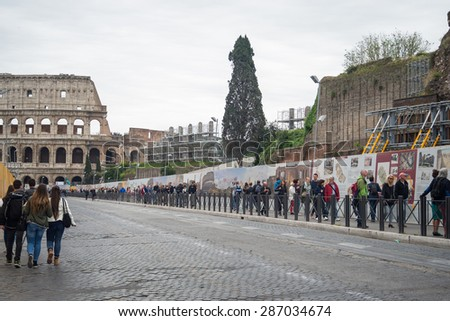 Rome, Italy - April 27, 2015: Tourism at the Colosseum or Coliseum, also known as the Flavian Amphitheatre, in Rome city centre, Italy. - stock photo