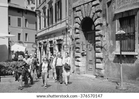 ROME, ITALY - APRIL 10, 2012: Tourists visit old district Trastevere in Rome. According to Euromonitor, Rome is the 3rd most visited city in Europe (5.5m international tourist arrivals 2009)