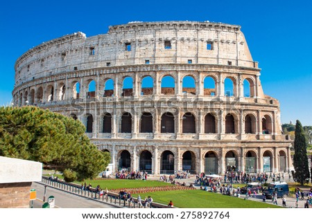 ROME - ITALY, APRIL 13, 2015: Tourists visiting the Colosseum on April 13, 2015. The Colosseum is an iconic symbol of Imperial Rome. It is one of Rome's most popular tourist attractions in Rome.