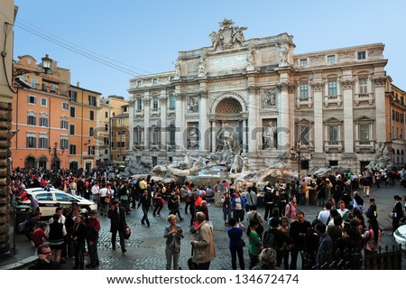 ROME, ITALY - APRIL 28: Visitors at Trevi Fountain on April 28 2011 in Rome, Italy.The Trevi Fountain is 26 mt high and 20 mt wide, it is one of the most famous fountains in the world. - stock photo